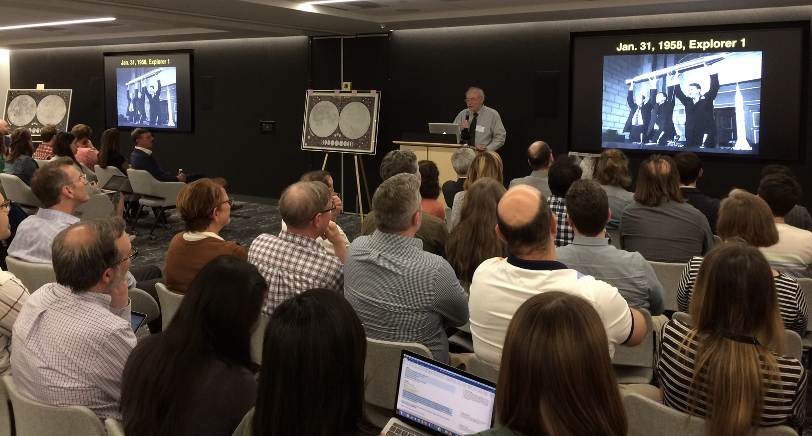 photo of Richard Furno presents to a full room the story of how the Moon Map was created.